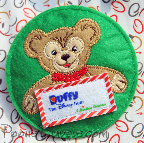"""Duffy """"pins"""" some Cast Members were given with their uniforms"""