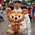 Cast Member with his Duffy designed balloon on Main Street